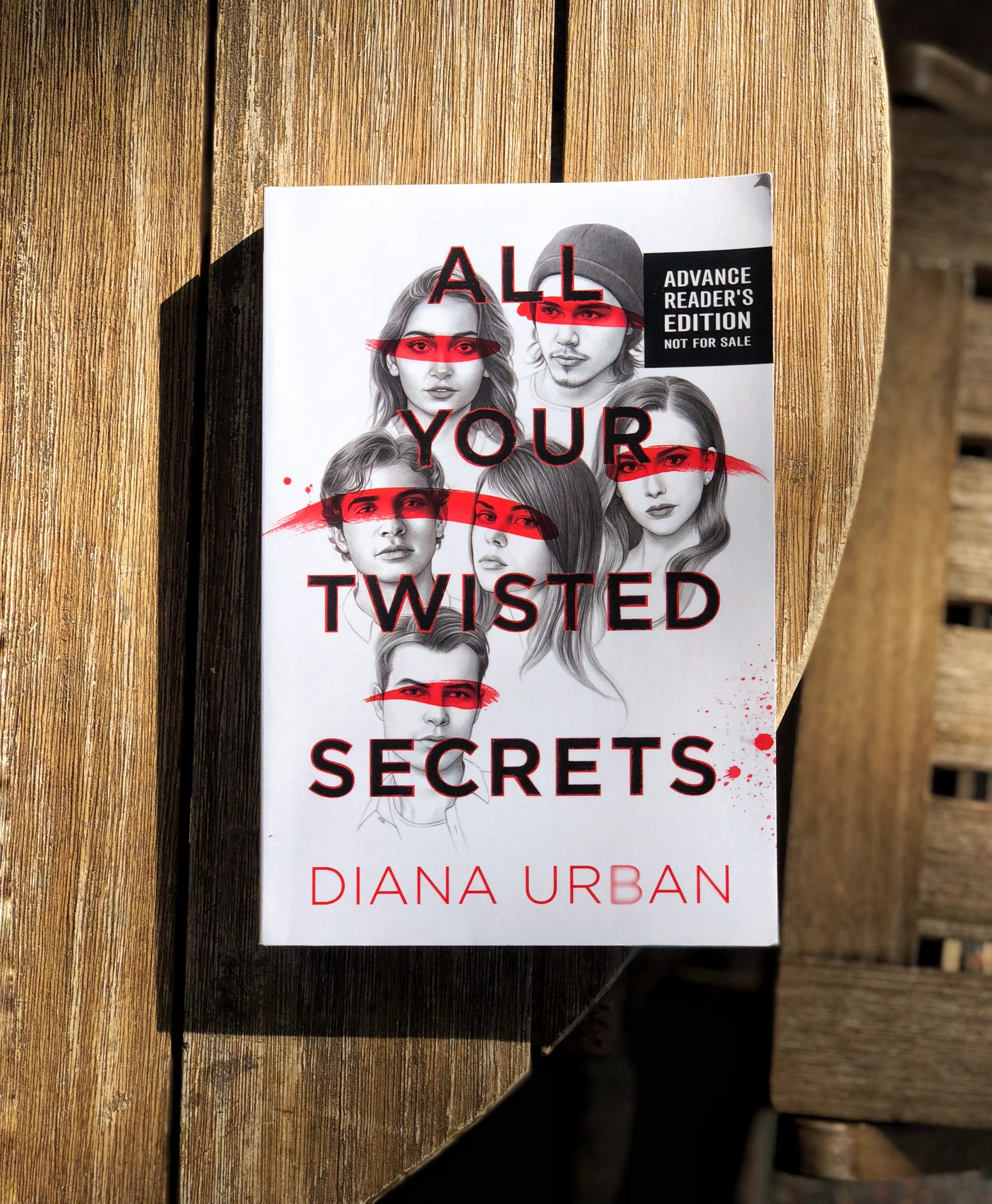 All Your Twisted Secrets on a Wooden Table